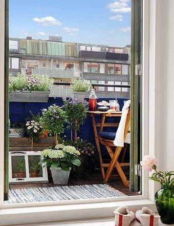 扩展功能后的阳台,巧妙地运用各种盆栽,营造出家中的微型花园