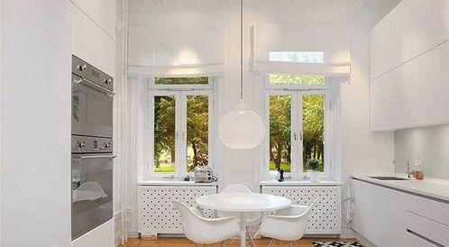 餐桌、餐椅的设计可真是简洁,白色的简约造型很是具有时尚感,整个空间充满了舒适、恬静的气息
