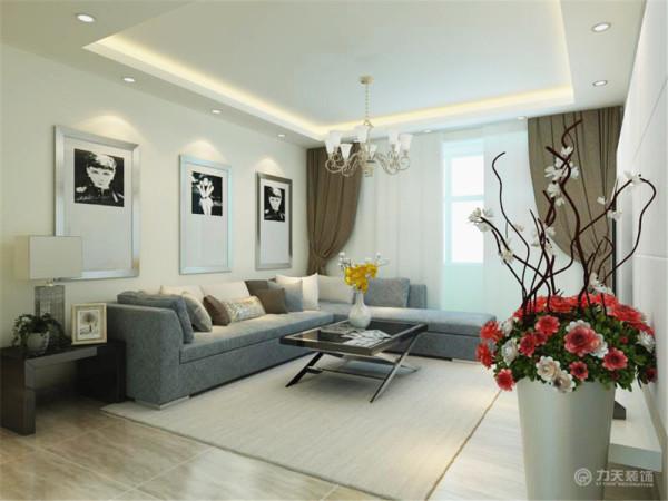 客厅沙发采用了拐角布艺沙发,沙发背景墙是简单的浅色乳胶漆和黑白